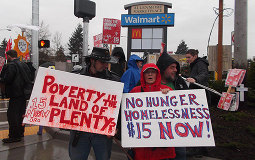 """Undaunted by rain, Tacoma marchers demand """"$15 now!"""""""