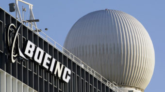 IAM Boeing workers narrowly approve 8-year contract extension