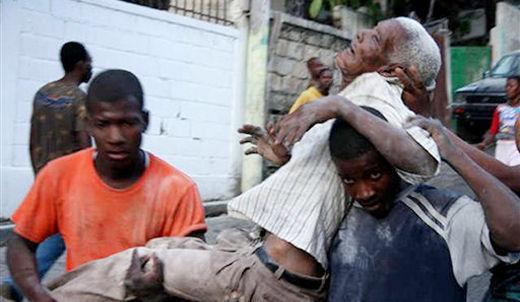 Haitians hold onto life as help mounts