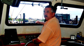 A shrimp boat captain worries and waits