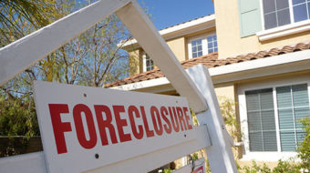 New foreclosures down, repossessions rise in April