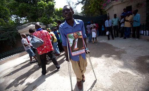 Amid Haiti election dispute, ex-President Aristide under house arrest