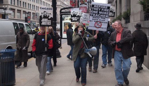 Video: Chicagoans march on monthly jobs report