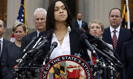 Baltimore prosecutor brings murder, manslaughter charges against six police