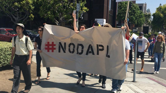 L.A. protest calls out security firm for involvement in attack on DAPL protesters