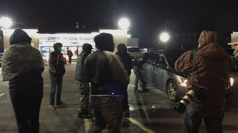 Activists call for a boycott of the Ferguson Market and Liquor convenience store