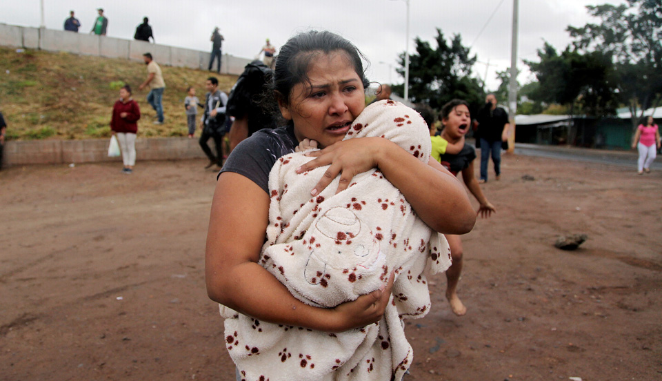 """""""Migrant caravan"""": Why they're really leaving home and risking it all"""