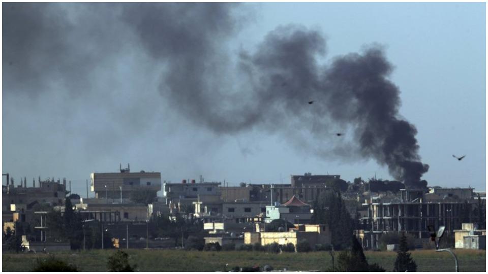 Turkish army and militia forces surround Kurdish towns as invasion advances
