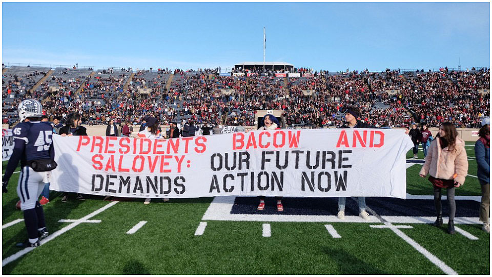 Yale-Harvard football game protesters demand divestment from fossil fuels