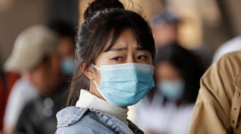 Trump sinks to racist panic as China mobilizes against disease