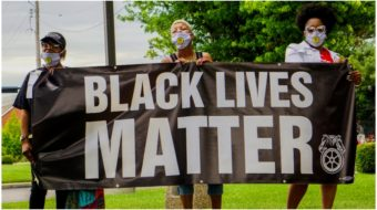 'Black Lives Matter' and 'Show Me $15' ring out at St. Louis strike