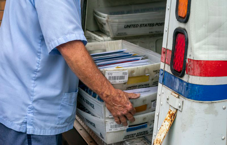 Postmaster General, a Trump crony, admits slowing the mail