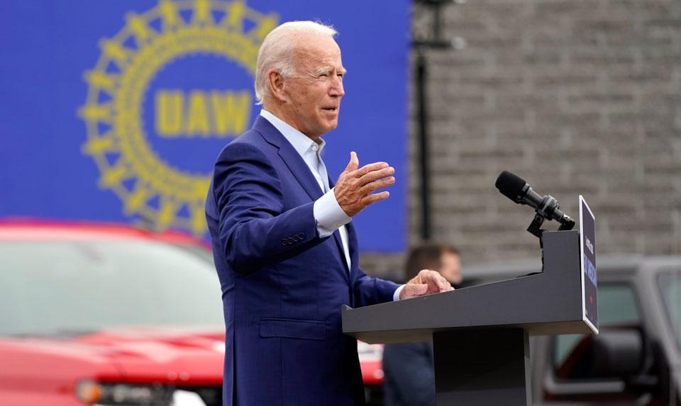 Biden tells UAW he plans clean energy factory future