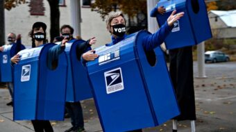 Put postal workers on the list of election heroes